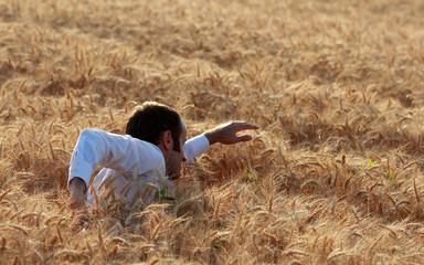 Businessman in a field