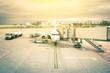 Leinwanddruck Bild - Modern airplane at tairport terminal gate ready for takeoff