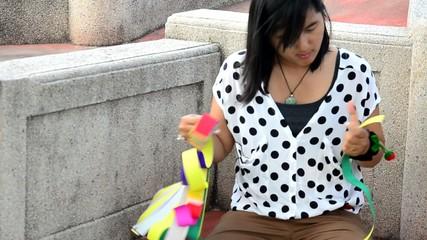 Thai woman prepare joss paper for burn in the Qingming Festival