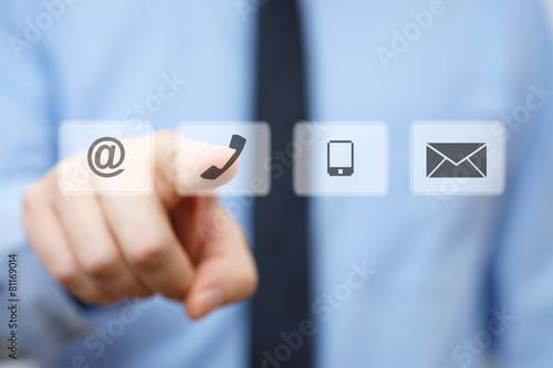 Leinwanddruck Bild businessman pressing phone button, company identification icons