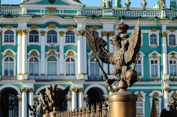 Double-headed eagle on background of Hermitage in St. Petersburg