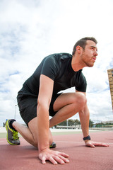 man ready to run on the track
