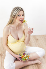 pregnant woman eating vegetable salad