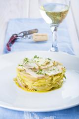 Timbal de bacalao asado con patatas perejil y aceite de oliva