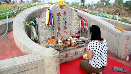 Thai woman praying graveyard of Ancestor Worshipping