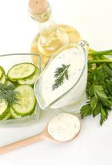 white sauce and slice of cucumber