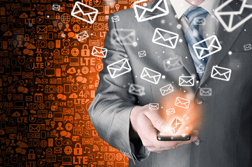 Business man holding smart phone and sending emails
