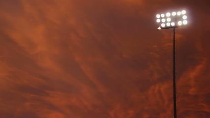 Stadium Lights With Orange Sky