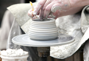 The potter during a jug molding..