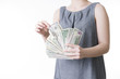 Woman with money in studio