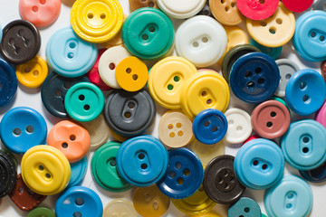 Many old buttons  on  a white background