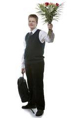 pupil of senior classes in school uniform with bouquet flowers..