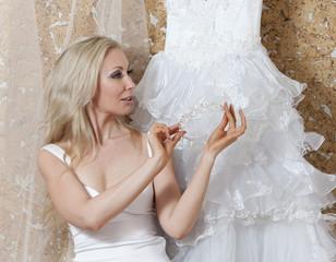 beautiful woman bride, near wedding dress