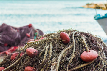 Detail of a fishing net in a small port
