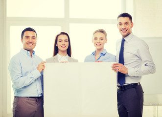 business team in office with white blank board