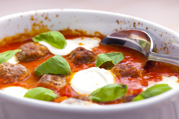 baked Bolognese balls with tomato, basil and fresh bull mozzarel
