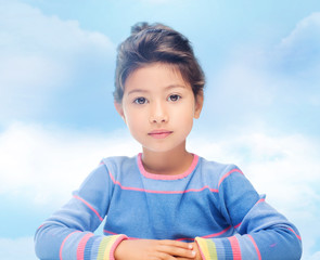 little girl over blue sky background
