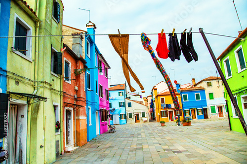 Leinwandbild Motiv Colorful houses in Burano with the laundry drying on a wire
