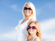 mother and child in sunglasses