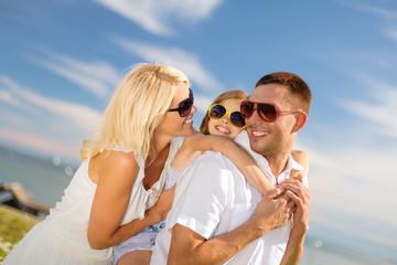 happy family in sunglasses having fun outdoors