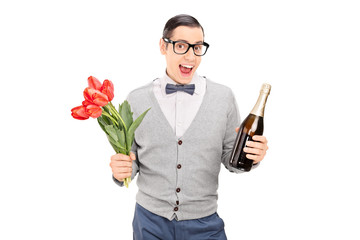 Young man holding tulips and a champagne