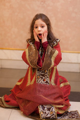 girl being concerned during theater performance