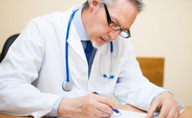 Mature doctor working in his studio