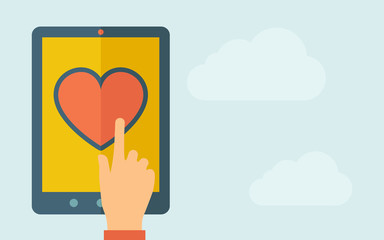 Touch screen tablet with the heart icon.