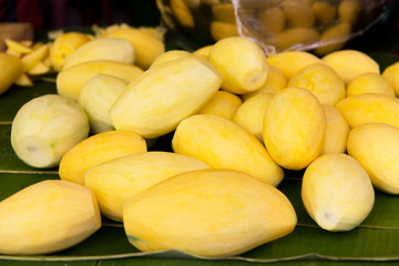 peeled mango at street market