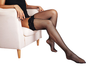 Beautiful woman with long sexy legs in the fishnet stockings.