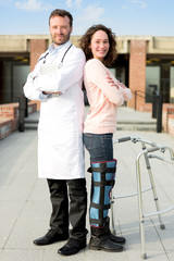 Young attractive patient and a doctor after a reeducation sessio