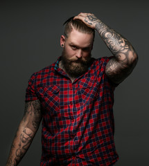 Men with beard and tattos on hands