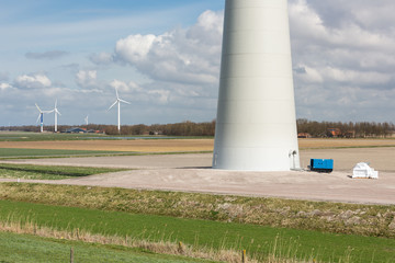 Foundation of a huge wind turbine in farmland of the Netherlands