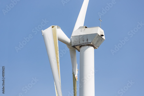 Wind turbine with broken wings after a storm - 81181625