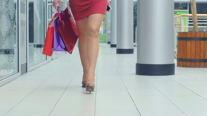 Female feet walking around the store, close up, Slow motion