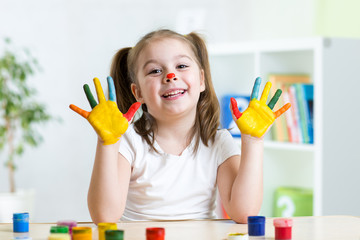 cute child painting her hands
