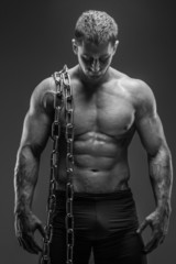 Strong man holds chain