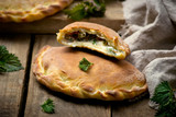 calzone with ricotta  and  nettle - 81184251