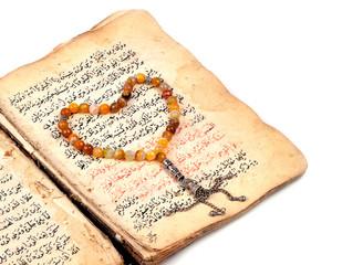 Manuscript Holy Quran and Muslim prayer beads