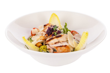 tasty fresh caesar salad with grilled chicken and parmesan