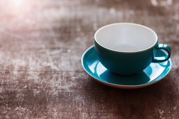 Coffee cup on a wooden table background