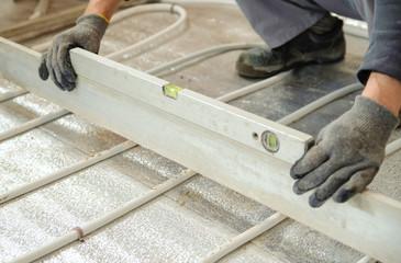 Man sets level concrete floor