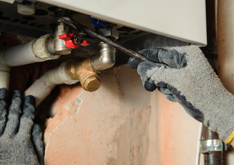 Man connects the gas boiler