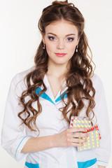 Beautiful intern girl with pills