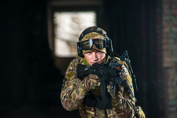 Airsoft strikeball player in military soilder uniform