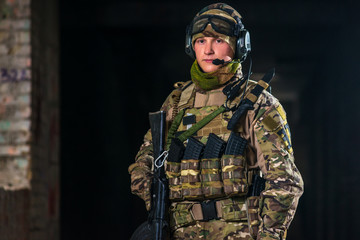 Airsoft strikeball player in military soilder uniform