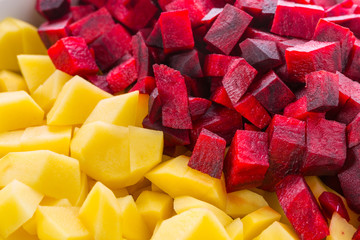 Sliced potatoes and beetroots for a soup