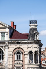 Upper part of the old town house on blue sky background