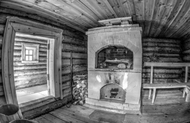 Interior of traditional russian wooden bath with brick oven. Bla