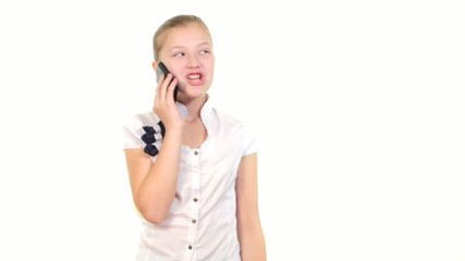 School girl using mobile phone and calls somebody, smiles on